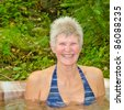 Laughing woman soaking in Hot Springs - stock photo