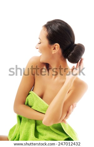 Laughing woman wrapped in towel. - stock photo