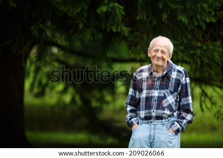 Laughing 80 year old senior elder man outside - stock photo