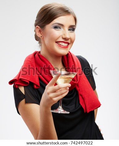Laughing young woman holding cocktail glass. isolated portrait.