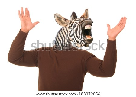 Laughing zebra face on a man's body with hands outstretched - stock photo