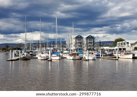 LAUNCESTON, TASMANIA-December 12, 2012, Launceston Seaport located on the Tamar river is home to modern apartments and numerous restaurants, as well as boat and yacht mooring - stock photo