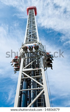 Launched free-fall with human legs over blue cloudy sky - stock photo