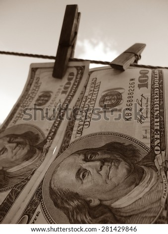 laundered dollars on a rope - stock photo