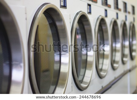laundromat machine washer line with closed doors (shallow depth of field)  - stock photo