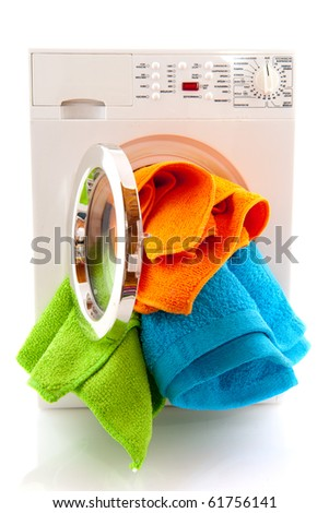 Laundromat with colorful laundry isolated over white - stock photo