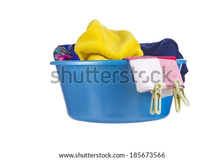 Laundry - blue wash-basin with clean clothes and clothespins