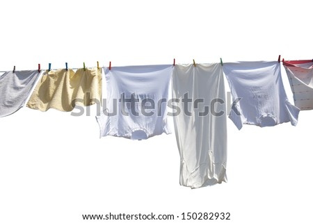 Laundry drying on the rope outside on a sunny day, isolated on white - stock photo