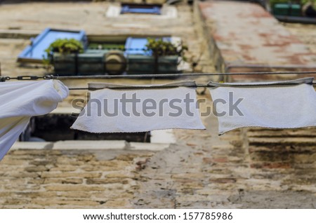 laundry hanging out on a clothesline in the street - stock photo