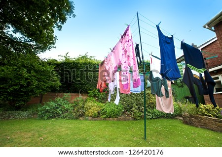 Laundry hanging out to dry outdoors in summer - stock photo