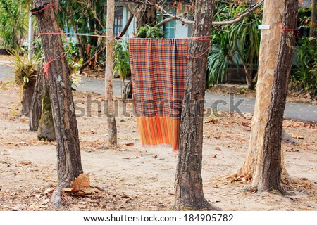 Laundry Hanging out to Dry Outdoors in Summer. - stock photo