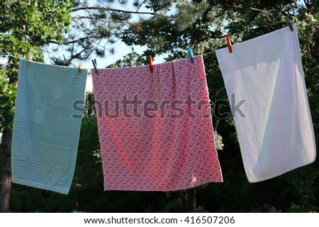 Laundry line with clothes in nature