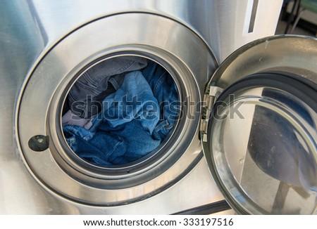 Laundry machine at work - stock photo