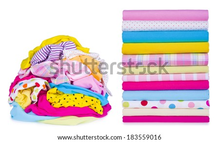 Laundry pile and clothes after ironing - stock photo