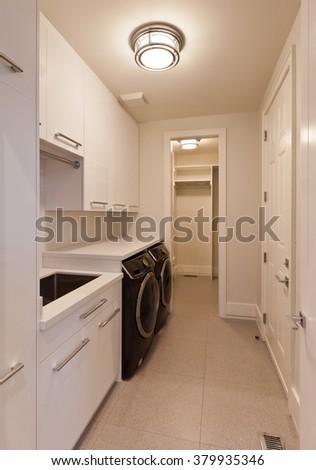 Laundry room in new luxury house - stock photo
