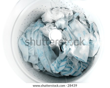 Laundry soaking in a clothes washer. - stock photo