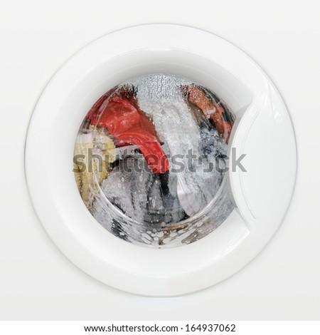 Laundry washing in machine drum - stock photo