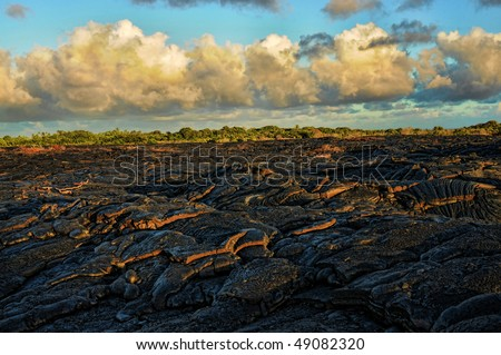 Lava flow under pacific skies - stock photo