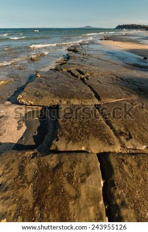 lava plates on New Zealand coast - stock photo