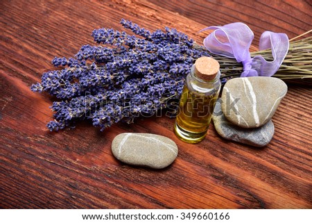 lavander oil with flower on wooden background