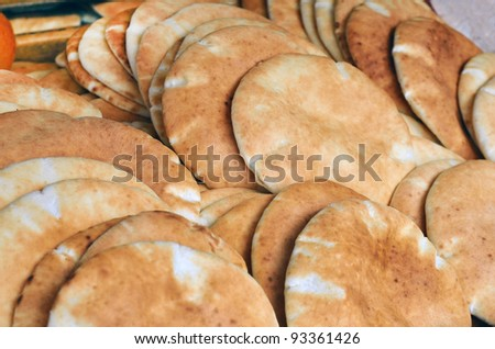 lavashes bread (pita) on market stand - stock photo