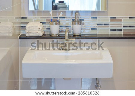 Lavatory and accessories with mosaic wall under the mirror