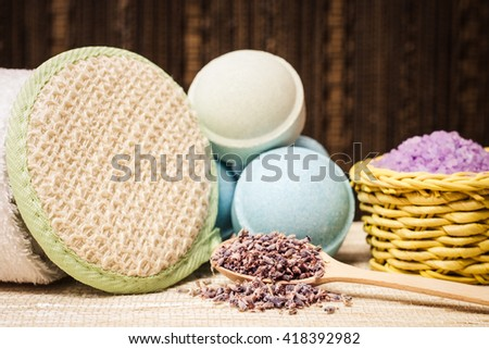 Lavender and organic bath cosmetic for beauty, aromatherapy, spa body care, relaxation, treanment. Herbal nature salt with herb, purple pant, flower. Natural aroma medicine. - stock photo