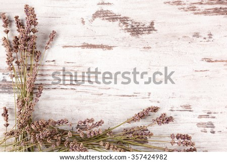 Lavender background. Lavender on white wooden antique textured background, top view, provence style. - stock photo