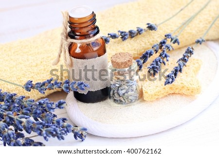 Lavender essential oil. Aroma oil bottles, dried lavender flowers. Herbal skincare.  - stock photo