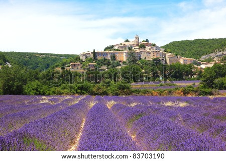 lavender field and old town of Banon, France - stock photo