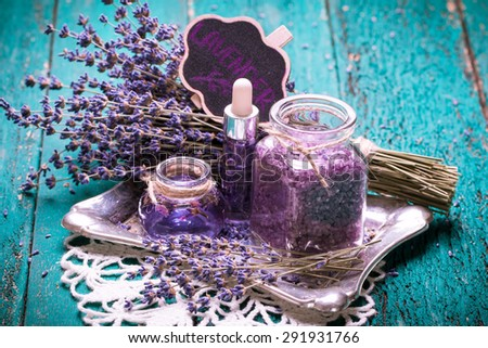 lavender flower,oil,salt, spa beauty concept. wood old background. - stock photo