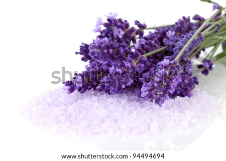 lavender flowers and bath salt over white background
