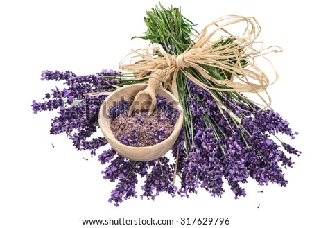 Lavender flowers and wooden mortar with bath salt over white background - stock photo