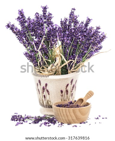 Lavender flowers and wooden mortar with bath salt over white background