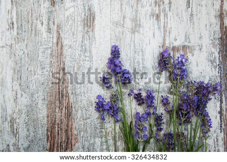 lavender flowers on a old wooden background - stock photo