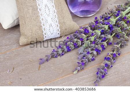 Lavender fresh flowers and dry in pouch on gray wooden table  - stock photo