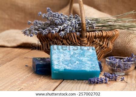 lavender handmade soap bars, on wooden background - stock photo