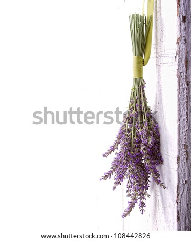 Lavender hanging from an old vintage door, room for copy space - stock photo