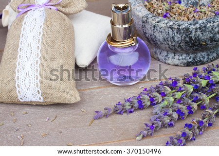 Lavender herbal water in a glass bottle with fresh and dry flowers  - stock photo