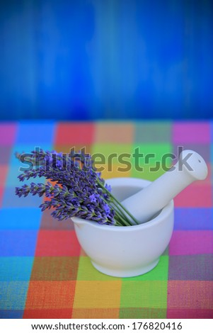 Lavender herbs in a mortar, healthy cosmetics concept - stock photo