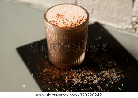 lavender hot cocoa drink on concrete background cool shadows natural light background - stock photo