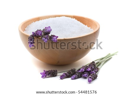 Lavender infused bathing salt with lavender over white background - stock photo