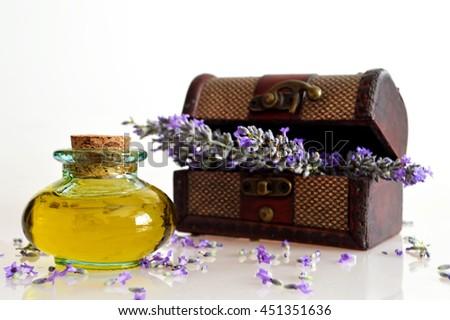 Lavender oil and lavender flower arrangement - stock photo