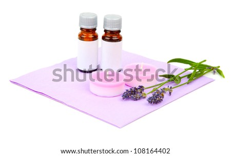 Lavender oil, candle and lavender flower, isolated on white background - stock photo