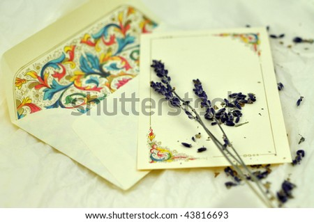 Lavender on decorated envelope and card - stock photo