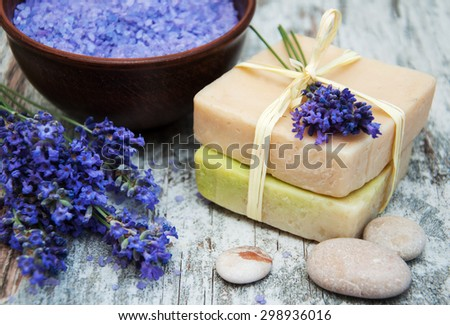 Lavender, sea salt and soap on a wooden background - stock photo