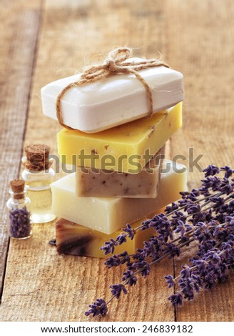 Lavender soap and salt on rustic wooden board. Spa concept - stock photo