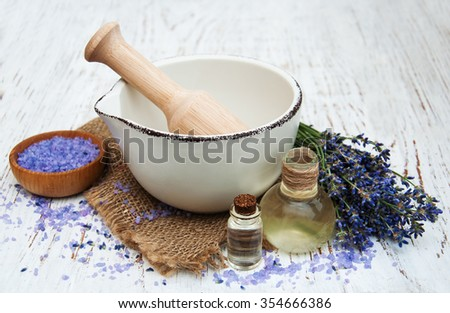 Lavender spa concept  lavender oil with bath salt and fresh lavender on a old wooden background - stock photo