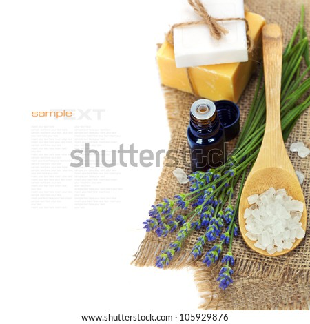 lavender spa (fresh lavender flowers,  essential oil, salt,  soap) over white  (with easy removable text) - stock photo