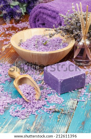 Lavender spa. Natural handmade lavender oil and soap with bath salt and lavender on rustic wooden background. Macro, selective focus - stock photo